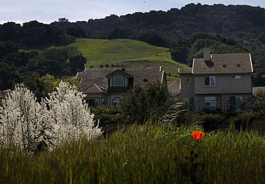 "Development and open space collide on the edge of a neighborhood called ""Moller Ranch"" on Monday March 15, 2010 in Pleasonton, Calif. An Alameda County judge recently ruled that the town's strict limit on new housing violates state law because the city can't build its share of required affordable housing. Photo: Mike Kepka, The Chronicle"