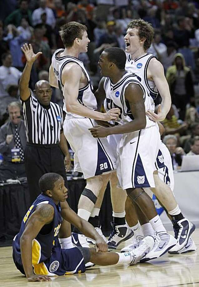 Butler players from left, Gordon Hayward, Shelvin Mack, and Matt Howard celebrate at the end of their NCAA second-round college basketball game as Murray State guard Isaiah Canaan, bottom left, looks on in San Jose, Calif., Saturday, March 20, 2010. Butler won the game 54-52. Photo: Paul Sakuma, AP