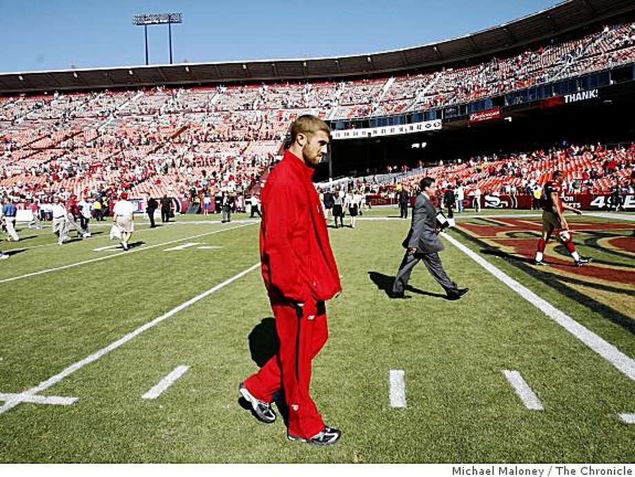 Injured San Francisco 49ers quarterback Alex Smith (11) walks off the field after the game.The San Francisco 49ers host the Arizona Cardinals in  their NFL  season opener at Candlestick Park in San Francisco, Calif., on Sept. 7, 2008. Arizona won 23-13. Photo: Michael Maloney, The Chronicle
