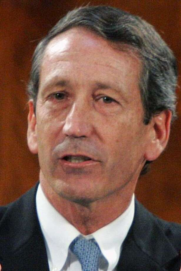 In this file photo taken Jan. 20, 2010, Gov. Mark Sanford delivers his last State of the State address to the joint legislative session at the Statehouse in Columbia, S.C. Sanford has agreed to pay $74,000 in fines to resolve dozens of charges thathe violated state ethics laws with his campaign spending and travel, including a taxpayer-funded rendezvous with his Argentine mistress, the State Ethics Commission said Thursday, March 18, 2010. Photo: Mary Ann Chastain, AP