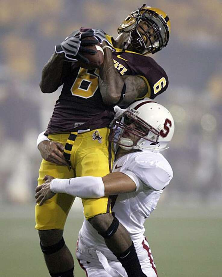 Arizona State wide receiver Kyle Williams, left, makes a reception as he is hit by Stanford cornerback Mark Mueller in the first quarter of an NCAA football game Saturday, Sept. 6, 2008, in Tempe, Ariz. (AP Photo/Paul Connors) Photo: Paul Connors, AP