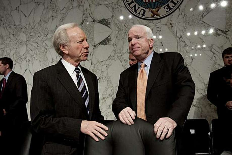 The Senate Armed Services Committee's ranking Republican Sen. John McCain, R-Ariz., right, talks with committee member Sen. Joseph Lieberman, I-Conn. on Capitol Hill in Washington, Thursday, March 4, 2010, before the start of the committee's hearing on the Air Force's fiscal 2011 budget. Photo: Harry Hamburg, AP