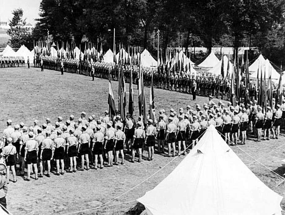 "FILE - In this Sept. 6, 1937 file photo, Rows of Hitler Youth are drawn up in rows to listen to a speech at the special Hitler Youth Camp, in Berlin, Germany. Newly declassified British intelligence files reveal the ripples of alarm that spread through the country as Hitler Youth cyclists toured Britain in 1937. Reports of sightings poured in from local police amid fears the teenagers might be two-wheeled ""spyclists"" scouting the country for a future invasion. The Hitler Youth group aimed to instill the Nazis' racist and xenophobic ideals into young Germans, through a mix of indoctrination, outdoor activities and military-style training. Before World War II, members of the group visited Britain, and MI5 documents released Monday by the National Archives Photo: AP"