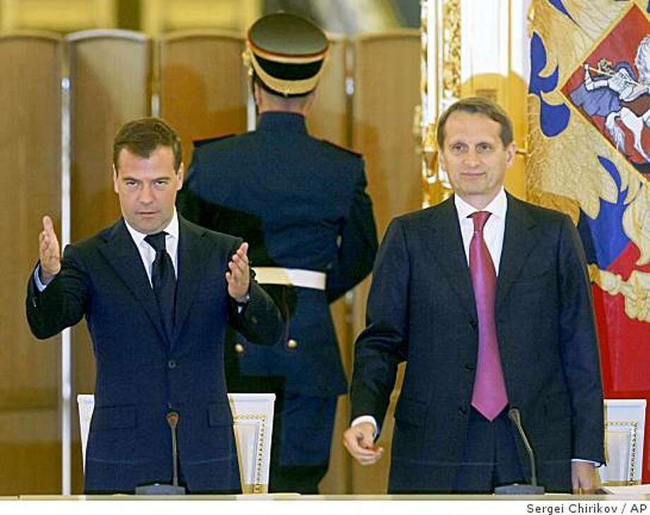 """Russian President Dmitry Medvedev,left,  gestures opening the State Council meeting in the Kremlin in Msocow, Saturday, Sept. 6, 2008.  At right is Sergei Naryshkin, head of Russian President's administration. President Dmitry Medvedev said Saturday the war with Georgia has shown the world that """"Russia is a nation to be reckoned with,"""" his most aggressive comments to date on the conflict with Russia's southern neighbor. (AP Photo/Sergei Chirikov, Pool) Photo: Sergei Chirikov, AP"""