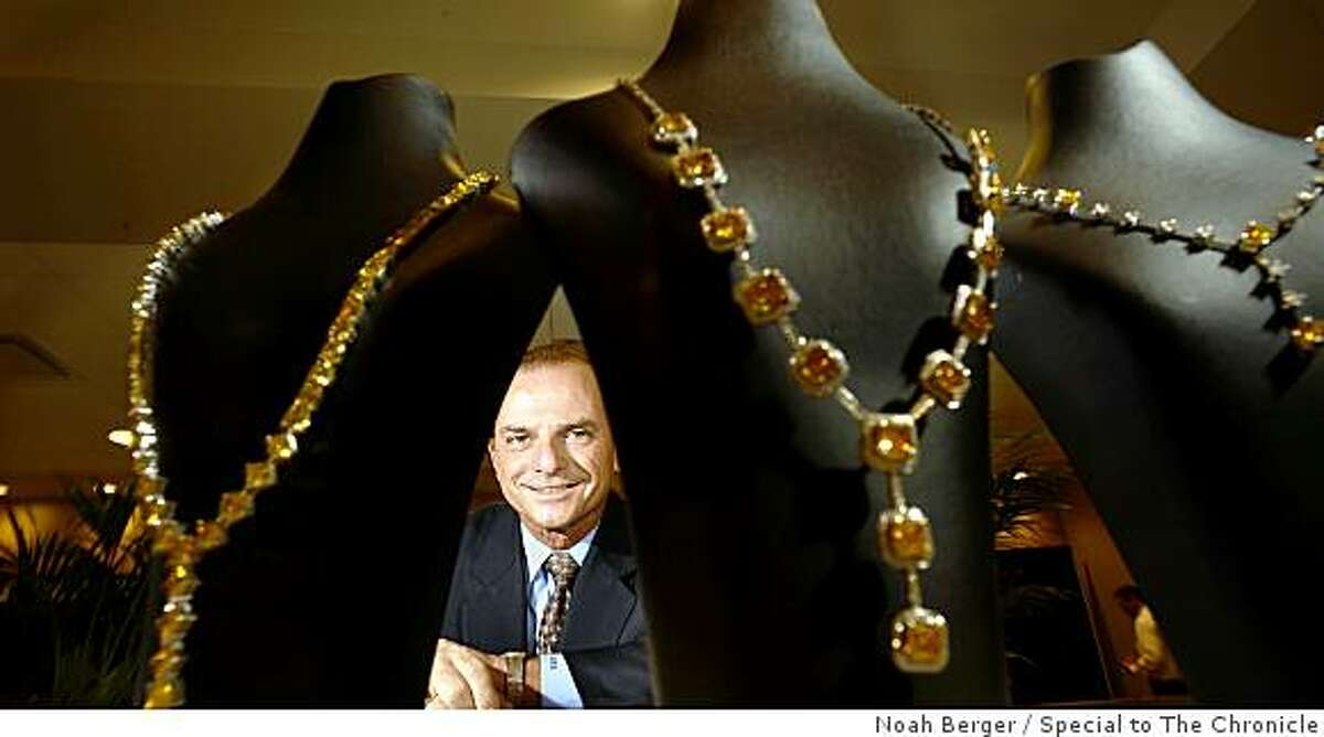 Steve Lux, CEO of Florida-based Gemesis Corporation, displays necklaces featuring lab-grown diamonds on Saturday, Aug. 23, 2008, in San Francisco.