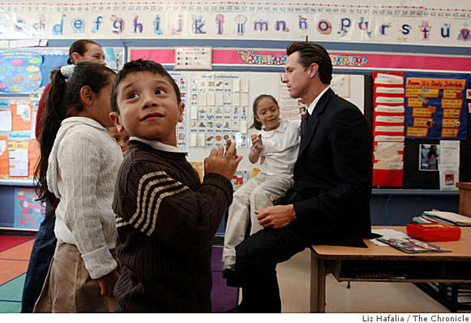 Mayor Gavin Newsom (right) visits a multi grade class at Sanchez Elementary School, on Tuesday, September 9, 2008.  Second grader Rita Tapia visiting with Newsom as kindergartener Jason Medina (front) waits for his turn in San Francisco, Calif. Photo: Liz Hafalia, The Chronicle