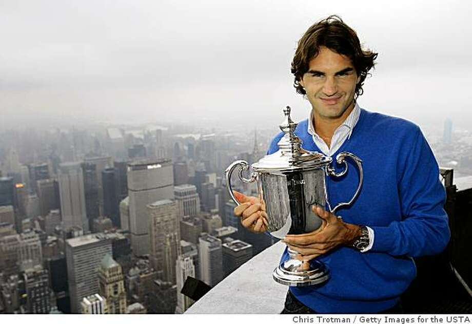 NEW YORK - SEPTEMBER 09:  Roger Federer the 2008 US Open Tennis Champion poses with his trophy on a viewing deck at the Empire State Building on September 9, 2008 in New York City.  (Photo by Chris Trotman/Getty Images for the USTA) Photo: Chris Trotman, Getty Images For The USTA
