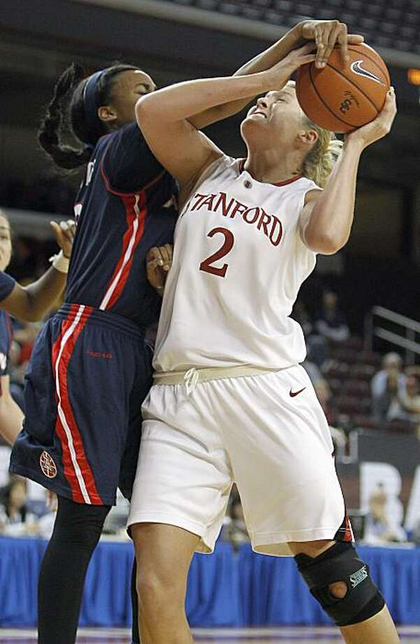 Stanford center Jayne Appel gets fouled by Arizona guard Davellyn Whyte going up for a shot in the second half of an NCAA college basketball game in the Pac-10 women's tournament in Los Angeles Friday, March 12, 2010. Stanford won 72-52. Photo: Alex Gallardo, AP