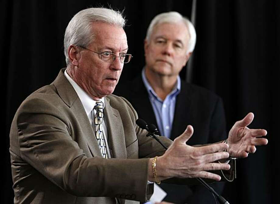 Bob Waltz, Toyota Motor Sales USA Vice President of Product Quality and Service Support, left, speaks as Toyota Motor Sales USA Vice President of Communications Mike Michels looks on during a news conference held Monday, March 15, 2010 in San Diego.  Toyota held the news conference to share preliminary findings of the company's technical investigation into an alleged incident of unintended acceleration involving a 2008 Toyota Prius driven by James Sikes. Photo: Denis Poroy, AP