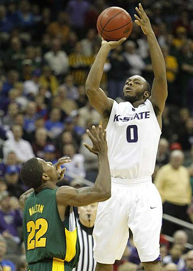 Kansas State guard Jacob Pullen (0) shoots over Baylor guard A.J. Walton (22) during the second half of an NCAA college basketball game at the Big 12 tournament Friday, March 12, 2010, in Kansas City, Mo. Kansas State defeated Baylor 82-75. Pullen scored26 points in the game. Photo: Charlie Neibergall, AP