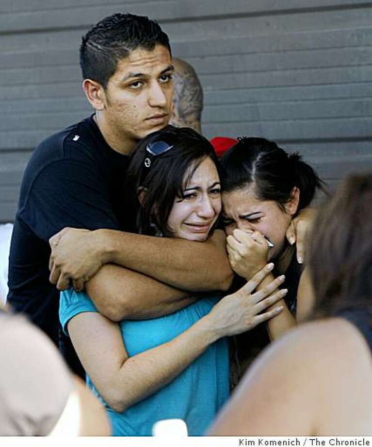 Family and friends react to confirmation of the identity of one of the victims after a multiple homicide in Martinez, Calif., on Saturday, Sept. 6, 2008. Photo: Kim Komenich, The Chronicle