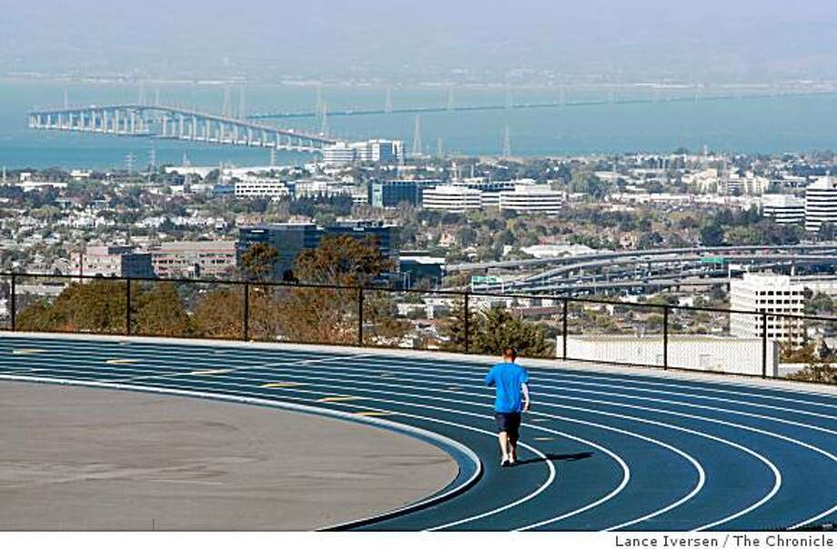 A jogger takes advantage of San Mateo City College track and its almost perfect weather and view of the city as he runs laps. Photo: Lance Iversen, The Chronicle