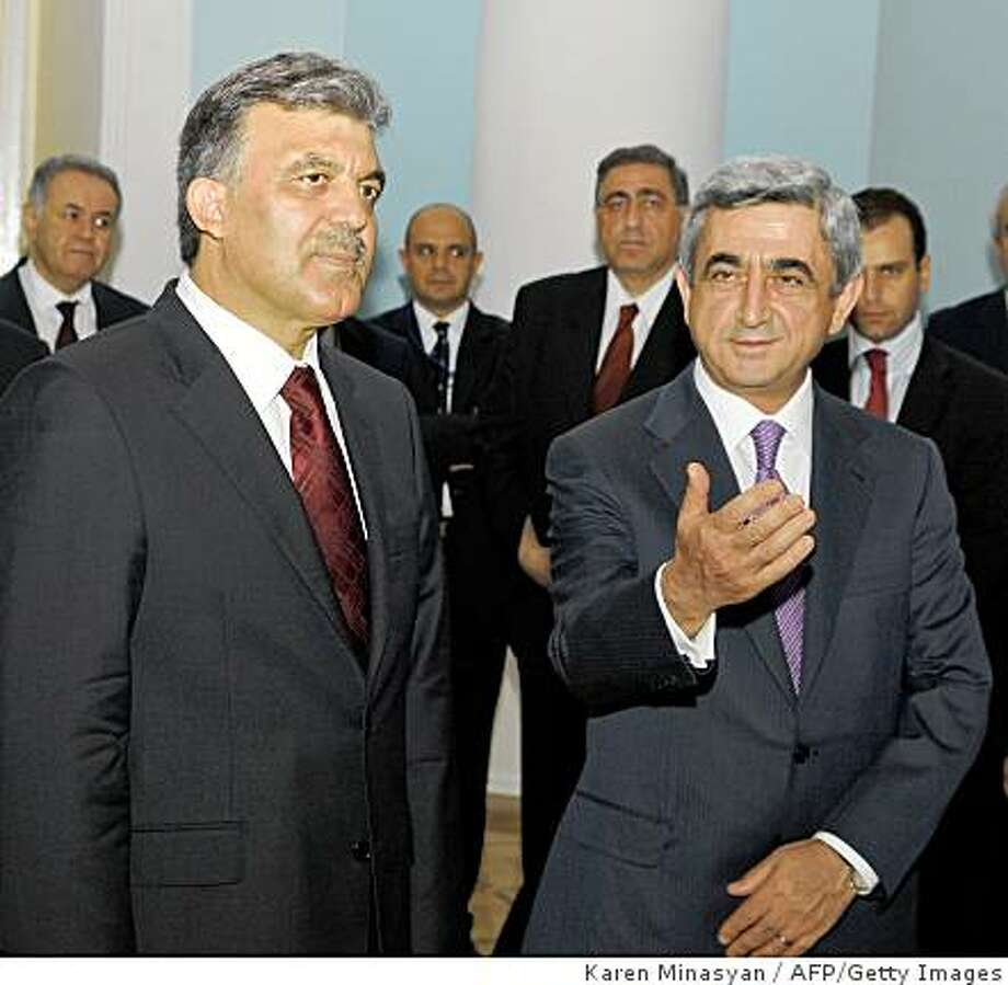 Armenian President Serzh Sarkisian (R) gestures as he meets his Turkish counterpart Abdullah Gul on September 6, 2008 during a meeting in Yerevan. Sarkisian said today he had been invited by his Turkish counterpart Abdullah Gul to attend a return football match between the two nations in Turkey next month. Gul travelled today to attend the World Cup qualifiers between Armenia and Turkey, in a landmark visit expected to ease relations between the two foes.   AFP PHOTO/ KAREN MINASYAN (Photo credit should read KAREN MINASYAN/AFP/Getty Images) Photo: Karen Minasyan, AFP/Getty Images