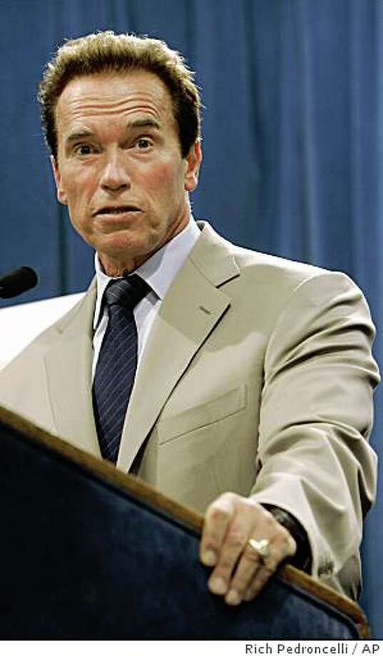 Gov. Arnold Schwarzenegger answers a question concerning the state's response to a magnitude-5.4 earthquake that struck the area earlier in the day, during a news conference in Sacramento, Calif., Tuesday, July 29, 2008. Schwarzenegger said the state was assessing levees, bridges, power lines, roads and hospitals but that no major damage had been reported.  (AP Photo/Rich Pedroncelli) Photo: Rich Pedroncelli, AP