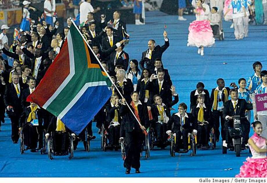 BEIJING, CHINA - SEPTEMBER 6:  Natalie du Toit leads out the South African participants during the 2008 Beijing Paralympic Games Opening Ceremony held September 6, 2008 in Beijing, China.  (Photo by Duif du Toit/Gallo Images/Getty Images) Photo: Gallo Images, Getty Images