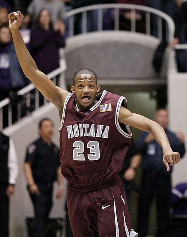 Montana's Anthony Johnson reacts during the final seconds of Montana's  win over Weber State in the NCAA, Big Sky Conference championship basketball game, Wednesday, March 10, 2010 in Ogden, Utah. Johnson scored a tournament record, 42 points. Photo: Colin E Braley, AP