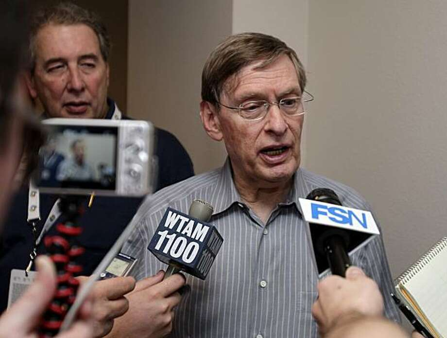 Baseball commissioner Bud Selig talks with reporters in the press box during a spring training baseball game between the Cincinnati Reds and Cleveland Indians Saturday, March 6, 2010, in Goodyear, Ariz. Photo: Mark Duncan, AP
