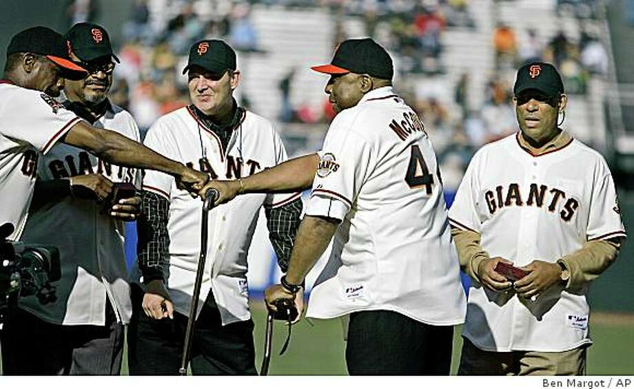 Former San Francisco Giants first basemen and Hall of Famers Orlando Cepeda, right, and Willie McCovey, second from right, greet other former teammates as part of a tribute to Giants infielders over the past 50 years prior to the baseball game against the Oakland Athletics Saturday, June 14, 2008, in San Francisco. (AP Photo/Ben Margot) Photo: Ben Margot, AP
