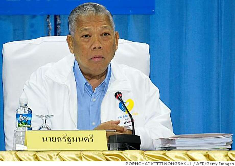 Thai Prime Minister Samak Sundaravej attends a mobile cabinet meeting in Udon Thani province on September 09, 2008. Samak awaited a court verdict on accusations that his TV cooking show violated the constitution, which could see him forced from office, at least temporarily.    AFP PHOTO/PORNCHAI KITTIWONGSAKUL (Photo credit should read PORNCHAI KITTIWONGSAKUL/AFP/Getty Images) Photo: PORNCHAI KITTIWONGSAKUL, AFP/Getty Images