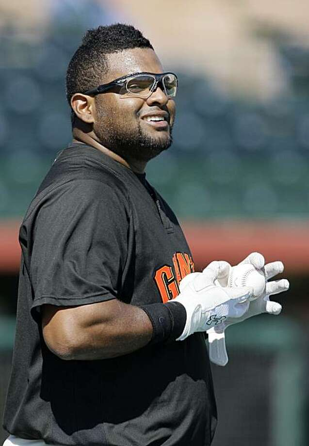 San Francisco Giants' Pablo Sandoval smiles during warm ups before a spring training baseball game against the Seattle Mariners in Scottsdale, Ariz., Thursday, March 11, 2010. Sandoval is taking a lot of flak for his weight. Photo: Jeff Chiu, AP