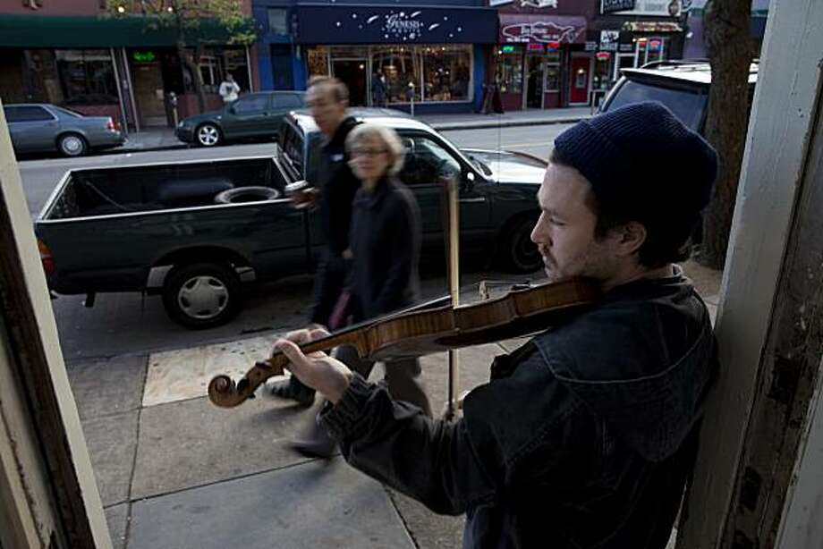 Busker Nick Stillman plays his fiddle on Haight Street on February 24, 2010 in San Francisco, California. Photograph by David Paul Morris / Special To The Chronicle Photo: David Paul Morris, The Chronicle