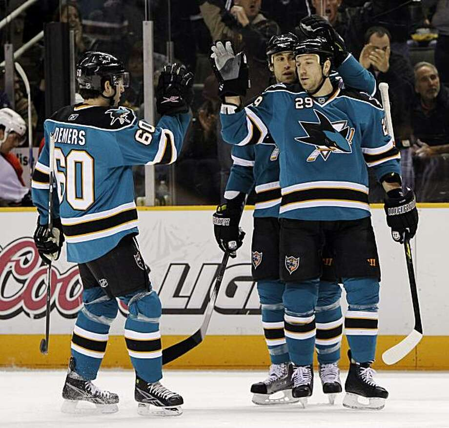 San Jose Sharks left wing Ryane Clowe, right, celebrates his goal with teammates Jay Leach, center, and Jason Demers during the first period of an NHL hockey game in San Jose, Calif., Saturday, March 13, 2010. Photo: Marcio Jose Sanchez, AP