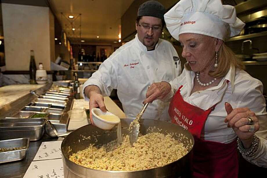 "Malin Giddings tastes her food as Chef Partner Marc Schoenfield looks on as socialtie ""celebrity guests"" compete in a pasta cook off at the Museo ItaloAmericano fundraiser at the Il Fornaio restaurant on March 1, 2010 in San Francisco, Calif. Photograph by David Paul Morris / Special to the Chronicle Photo: David Paul Morris, Special To The Chronicle"