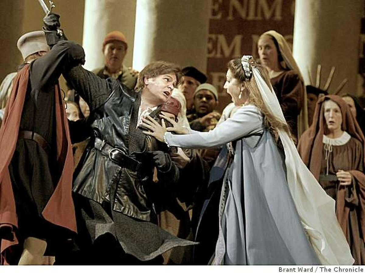 Marcus Haddock as Adorno is stopped from attacking Simon by Barbara Frittoli as Amelia in a scene from Act 1, scene 2. SF Opera opens its season with Verdi's epic Simon Boccanegra. These from dress rehearsal Tuesday, September 2, 2008.