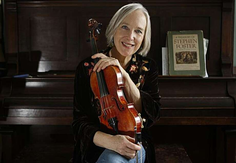 Performing artist and Berkeley native Laurie Lewis has been playing bluegrass fiddle since she was a teenager, and talks about her recently released album at home in Berkeley, Ca., on Tuesday, January 26, 2010.  It is a breakthrough album of new age instrumental music. Photo: Liz Hafalia, The Chronicle