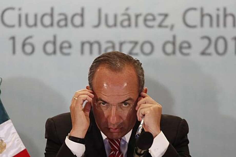 Mexico's President Felipe Calderon gestures during a press conference in Ciudad Juarez, Mexico, Tuesday, March 16, 2010.  Calderon is on a one-day visit to the northern border city terrorized by drug gang violence. Photo: Miguel Tovar, Associated Press