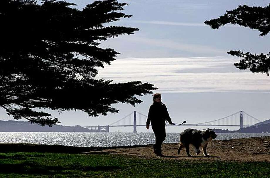 "Mary Lou McFadden, of Albany walks her dog ""Boomerang"" around the Point Isabel Regional Shoreline in Richmond, Calif. on Thursday Mar. 11, 2010. Photo: Michael Macor, The Chronicle"