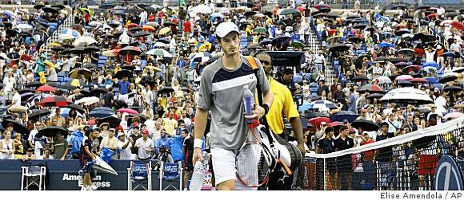 Andy Murray, of Britain, walks off the court following the suspension of play because of rain during his semifinal match against Rafael Nadal, of Spain, at the U.S. Open tennis tournament in New York, Saturday, Sept. 6, 2008. . (AP Photo/Elise Amendola) Photo: Elise Amendola, AP