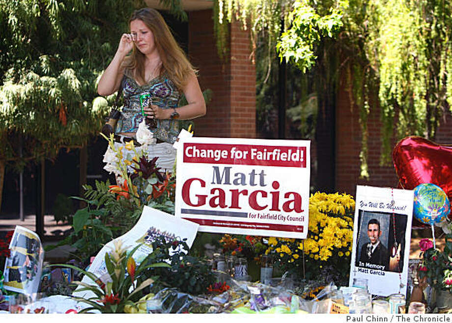 Mia Farmer, a friend from high school, visits a memorial arranged for Matt Garcia, after city officials announced that a youth center scheduled to open in the Fall will be renamed after the city council member in Fairfield, Calif., on Friday, Sept. 5, 2008. Garcia was shot and killed earlier this week and has stunned the community. Photo: Paul Chinn, The Chronicle