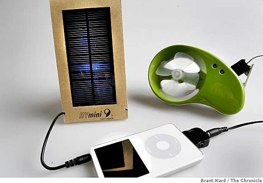 These two devices can charge your iPod using wind and solar power. Portable chargers to take on the road draw power from the wall, the dash, batteries, even the sun and the wind. Photographed in the Chronicle studio Tuesday, September 2, 2008. Photo: Brant Ward, The Chronicle
