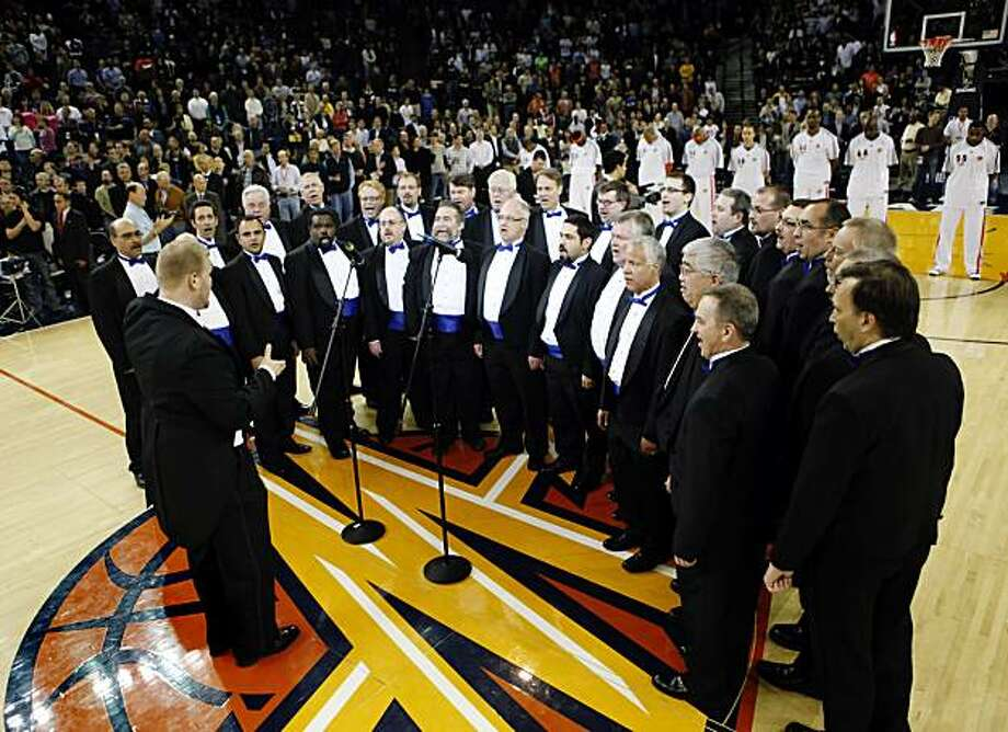 The Oakland Gay Men's Chorus sings the national anthem before the Warrior's basketball game against the Portland Trail Blazers at Oracle Arena in Oakland, Calif., on Thursday, March 11, 2010. The Golden State Warriors hosted their first Lesbian, Gay, Bi-Sexual and Transgender Night. A portion of ticket proceeds went to Positive Resource Center, an AIDS organization. Photo: Carlos Avila Gonzalez, The Chronicle