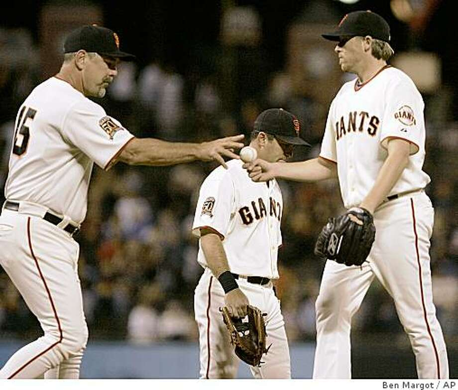 San Francisco Giants' Kevin Correia, right, gives up the ball as he is removed from the baseball game against the Pittsburgh Pirates by manager Bruce Bochy in the fifth inning of a baseball game Friday, Sept. 5, 2008, in San Francisco. (AP Photo/Ben Margot) Photo: Ben Margot, AP