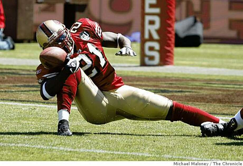 San Francisco 49ers Frank Gore (21) fumbles in the 1st quarter.The San Francisco 49ers host the Arizona Cardinals in  their NFL  season opener at Candlestick Park in San Francisco, Calif., on Sept. 7, 2008. Arizona won 23-13. Photo: Michael Maloney, The Chronicle