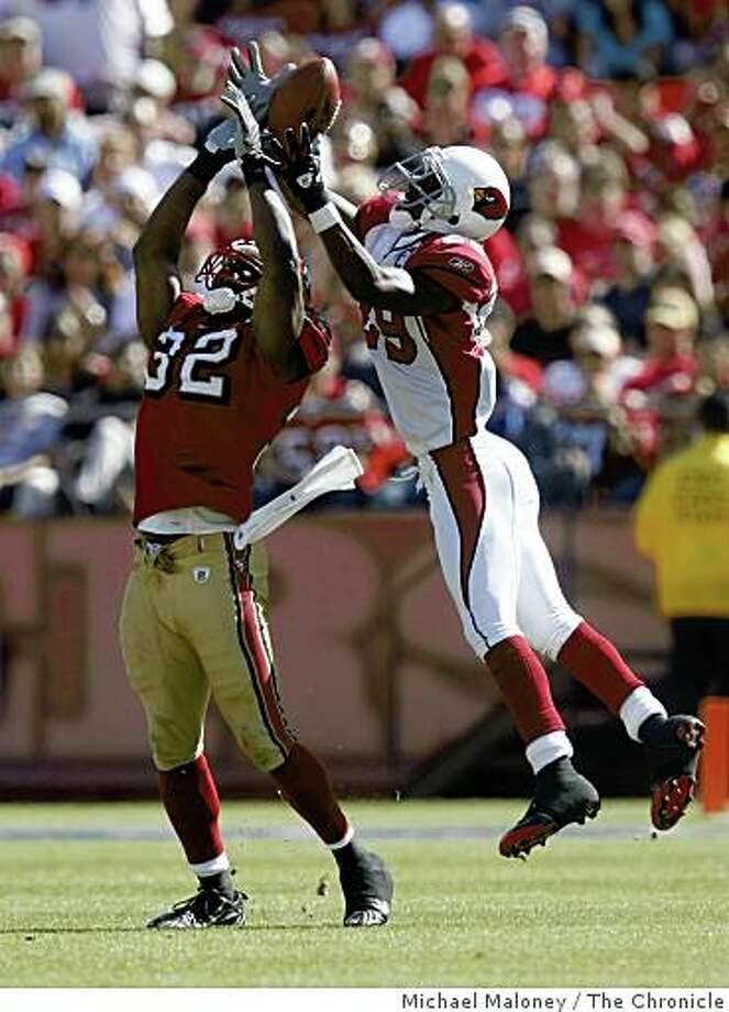 San Francisco 49ers Michael Lewis (32) breaks up a pass intended for Arizona Cardinals Dominique Rodgers-Cromartie (29) in the 4th quarter.The San Francisco 49ers host the Arizona Cardinals in  their NFL  season opener at Candlestick Park in San Francisco, Calif., on Sept. 7, 2008. Arizona won 23-13. Photo: Michael Maloney, The Chronicle