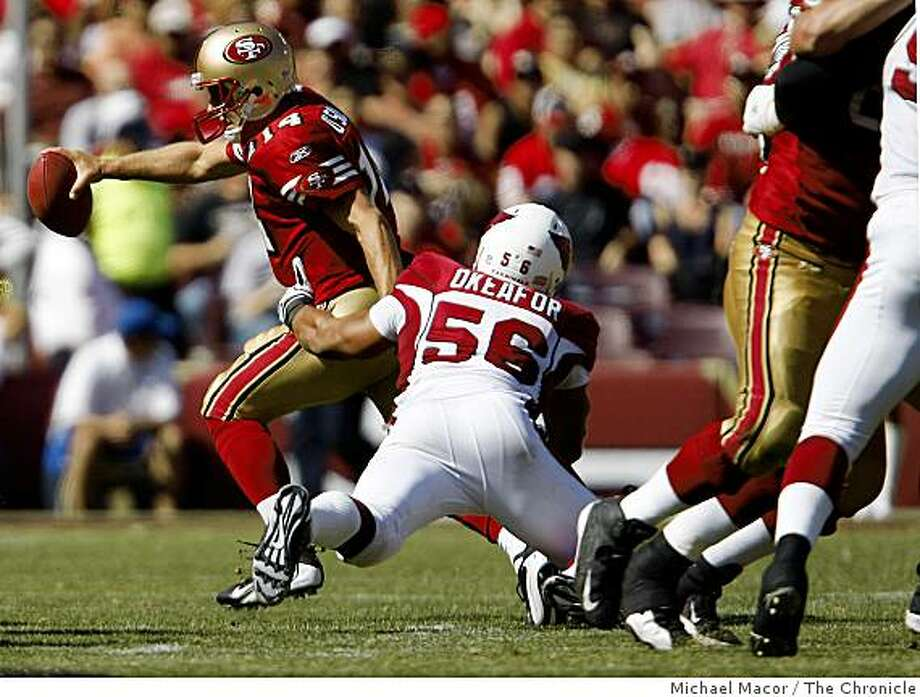 San Francisco 49ers quarterback J.T. O'Sullivan (14) scrambles away from Arizona Cardinals Chike Okeafor (56) in the 3rd quarter as the San Francisco 49ers take a loss against the Arizona Cardinals, 23-10 at Candlestick Park in San Francisco, Calif., on Sept. 7,2008. Photo: Michael Macor, The Chronicle