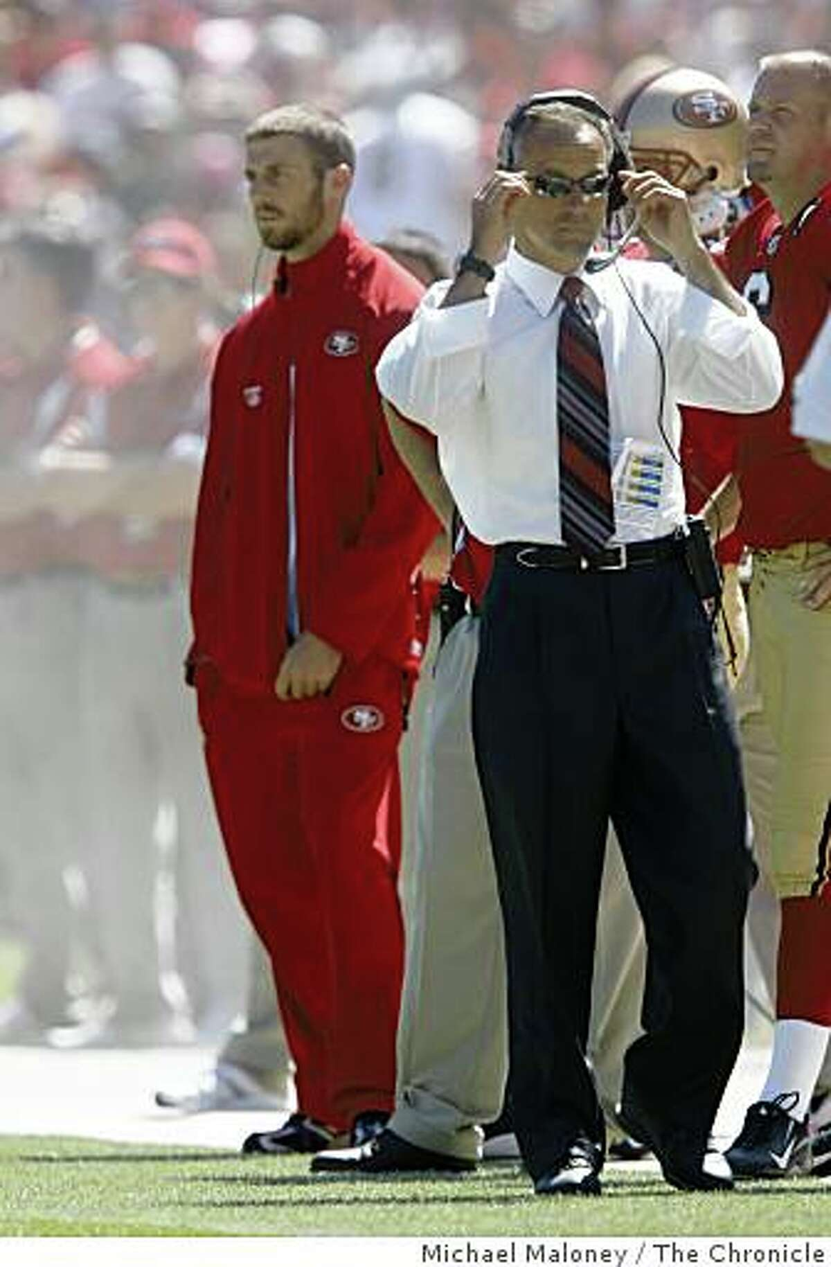 San Francisco 49ers injured quarterback Alex Smith (left) on the sidelines as head coach Mike Nolan roams the sidelines in the 2nd quarter.The San Francisco 49ers host the Arizona Cardinals in their NFL season opener at Candlestick Park in San Francisco, Calif., on Sept. 7, 2008.
