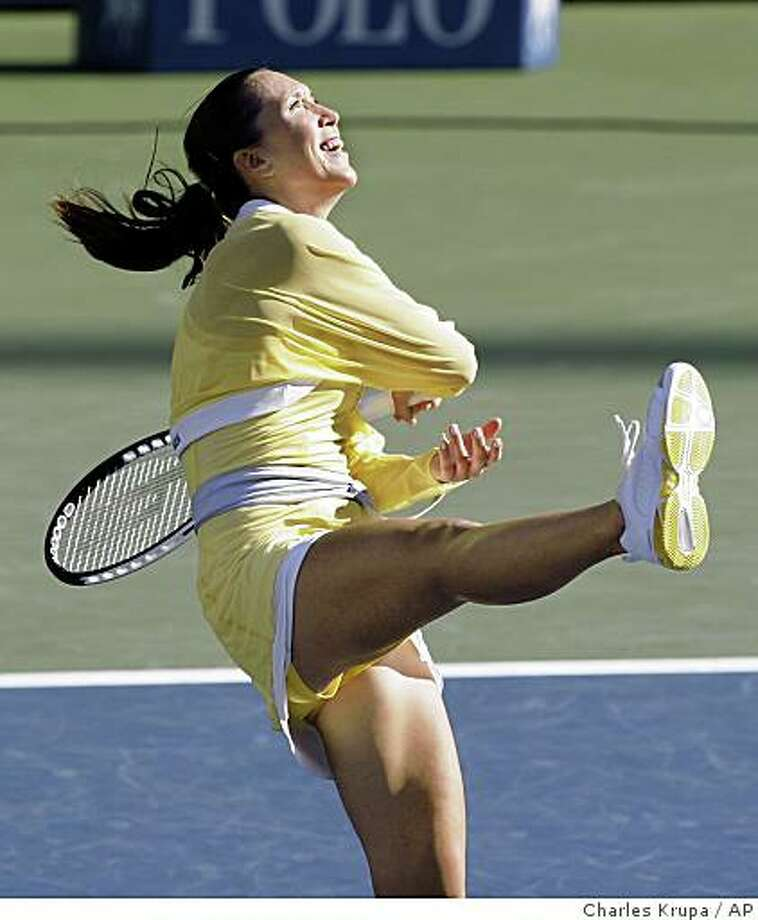 Jelena Jankovic, of Serbia, hits a ball into the stands after her two set victory over Elena Dementieva, of Russia, during their semifinal match at the U.S. Open tennis tournament in New York, Friday, Sept. 5, 2008. (AP Photo/Charles Krupa) Photo: Charles Krupa, AP