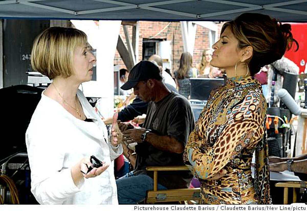 """Director Diane English and actress Eva Mendes on the set of """"The Women"""" (2008).holding as exclusive -NinaBTW-00221Women, The-, September 29, 2007Photo by Claudette Barius/picturehouse.wireimage.comTo license this image (14887934), contact WireImage.com"""