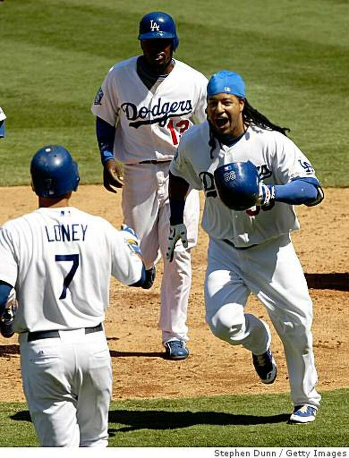 LOS ANGELES, CA - SEPTEMBER 06:  Manny Ramirez #99 of the Los Angeles Dodgers celebrates with James Loney #7 and Angel Berroa #13 after hitting a three run home run in the fifth inning against the Arizona Diamondbacks on September 6, 2008 at Dodger Stadium in Los Angeles, California.  (Photo by Stephen Dunn/Getty Images) Photo: Stephen Dunn, Getty Images