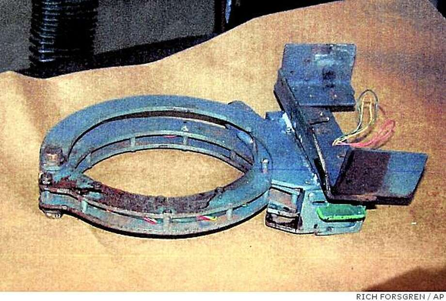 This image of a collar was released by the FBI at a press conference in Erie, Pa., Tuesday, Sept. 2, 2003. The collar with a locking mechanism was found on the body of pizza delivery man Brian Douglas Wells after an explosive device attached to the collar detonated after a bank robbery Thursday, Aug. 28, in Erie, Wells died from the blast. (AP Photo/Erie Times-News, Rich Forsgren) Photo: RICH FORSGREN, AP