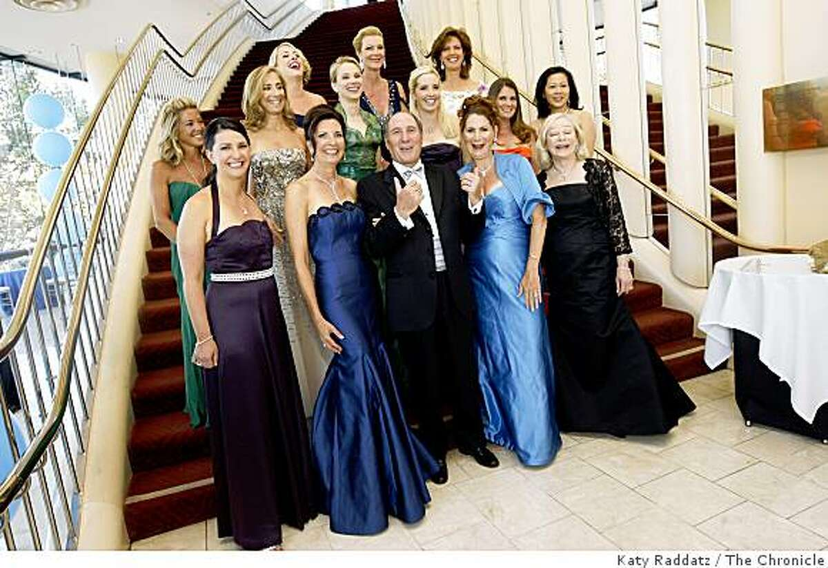 John Goldman, center, president of the San Francisco Symphony, surrounded by all the Chairs and Co-Chairs of the San Francisco Symphony, who are, clockwise from John Goldman, Karen Jung, Katherine Pellegrini, Stephanie Harman, Kathryn Lasater, Krista Mitzel, Catherine Hall, Pasha Thornton, Jessica Wu, Rebecca Green Bridsall, Gretchen Kimball, Carla Zuber, Patricia Ferrin Loucks, and Marissa Mayer , at the opening gala for the San Francisco Symphony, in San Francisco, Calif. on Wednesday, Sept. 3, 2008.
