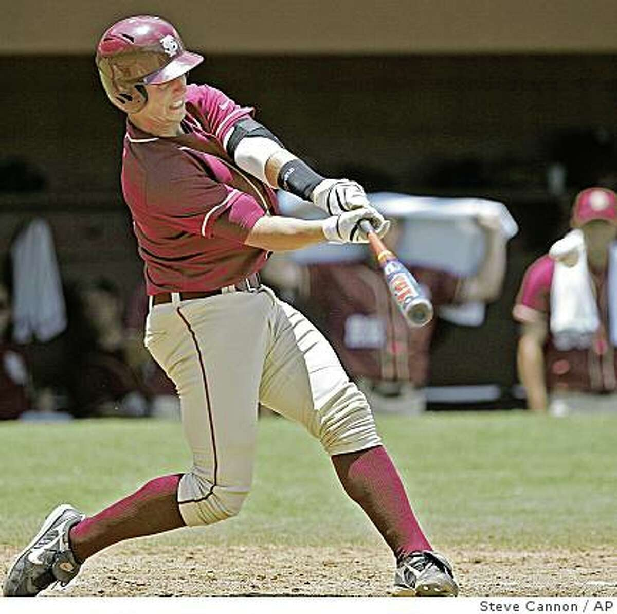 Florida State's Buster Posey connects for a grand slam in the third inning of a Tallahassee regional baseball game against Bucknell on Sunday, June 1, 2008 in Tallahassee, Fla. Florida State beat Bucknell 24-9.