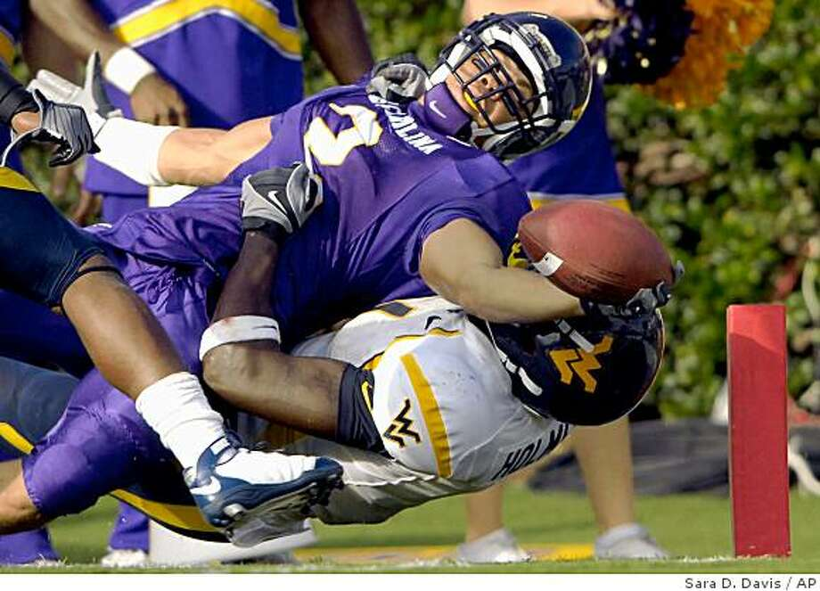 East Carolina's Jonathan Williams (2) is pulled down just shy of the endzone by West Virginia's John Holmes (1) during the first half of a NCAA college football game Saturday, Sept. 6, 2008 in Greenville, N.C. (AP Photo/Sara D. Davis) Photo: Sara D. Davis, AP