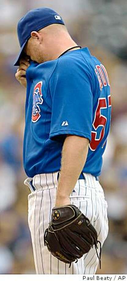 Chicago Cubs' relief pitcher Chad Gaudin reacts to the Washington Nationals' six runs scored in the ninth inning of a baseball game in Chicago, Friday, Aug. 22, 2008. (AP Photo/Paul Beaty) Photo: Paul Beaty, AP