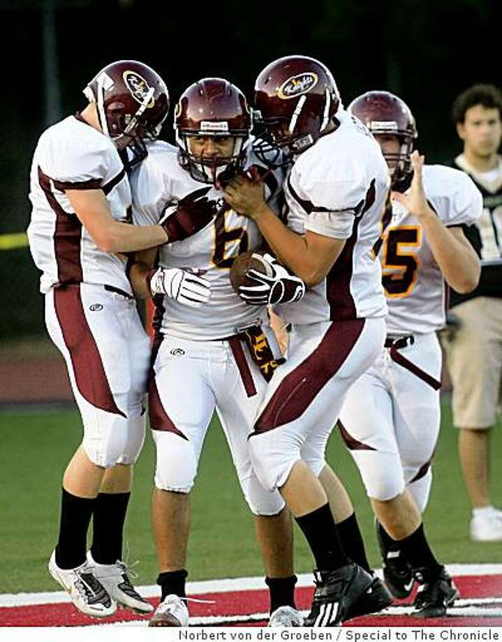 Las Lomas High's players  Darrin Thompson (center), celebrates with  Las Lomas teammates during game against Archbishop Mitty High School at Foothill College in Los Altos Hills.  Friday, September 5, 2008, Photo: Norbert Von Der Groeben, Special To The Chronicle