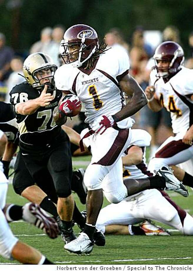 """Archbishop Mitty High's Trevor Wright(76) , tries to tackle Las Lomas High""""s  Diante Jackson (1) ,  during a high school football game at Foothill College in Los Altos Hills on Friday, September 5, 2008,  game. Photo: Norbert Von Der Groeben, Special To The Chronicle"""